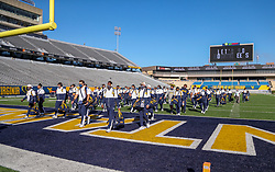 Oct 3, 2020; Morgantown, West Virginia, USA; West Virginia Mountaineers players arrive to their game against the Baylor Bears at Mountaineer Field at Milan Puskar Stadium. Mandatory Credit: Ben Queen-USA TODAY Sports