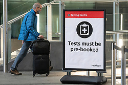 © Licensed to London News Pictures. 19/01/2021. London, UK. An arriving traveller enters a Covid-19 test centre in Heathrow Airport near London. Travel corridors in the the UK were closed at 04:00 hours on 18 January 2021 as British government declared. Travellers arriving to England from anywhere outside the UK have to to self-isolate for 10 days and must have proof of a negative coronavirus test. Photo credit: Ray Tang/LNP