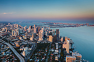 Aerial view of downtown Miami with Miami Beach in the distance at twilight looking north easterly