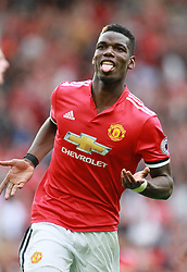 "Manchester United's Paul Pogba during the Premier League match at Old Trafford, Manchester. PRESS ASSOCIATION Photo. Picture date: Sunday August 13, 2017. See PA story SOCCER Man Utd. Photo credit should read: Richard Sellers/PA Wire. RESTRICTIONS: EDITORIAL USE ONLY No use with unauthorised audio, video, data, fixture lists, club/league logos or ""live"" services. Online in-match use limited to 75 images, no video emulation. No use in betting, games or single club/league/player publications."