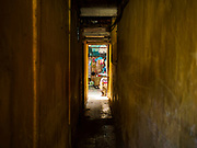 21 DECEMBER 2017 - HANOI, VIETNAM: A narrow passageway leading to apartments in central Hanoi.    PHOTO BY JACK KURTZ