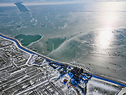 Nederland, Noord-Holland, Gemeente Waterland, 13-02-2021; Marken in de winter, het IJsselmeer (Markermeer) is deels bevroren. In de voorgrond de Rozewerf. De constructie in het water zijn ijsbrekers en deze beschermen het buurtschap tegen kruiend ijs.<br /> Marken in winter, the IJsselmeer (Markermeer) is partly frozen. In the foreground a hamlet, he structures in the water are icebreakers and these protect the hamlet against drifting ice.<br /> luchtfoto (toeslag op standaard tarieven);<br /> aerial photo (additional fee required)<br /> copyright © 2021 foto/photo Siebe Swart