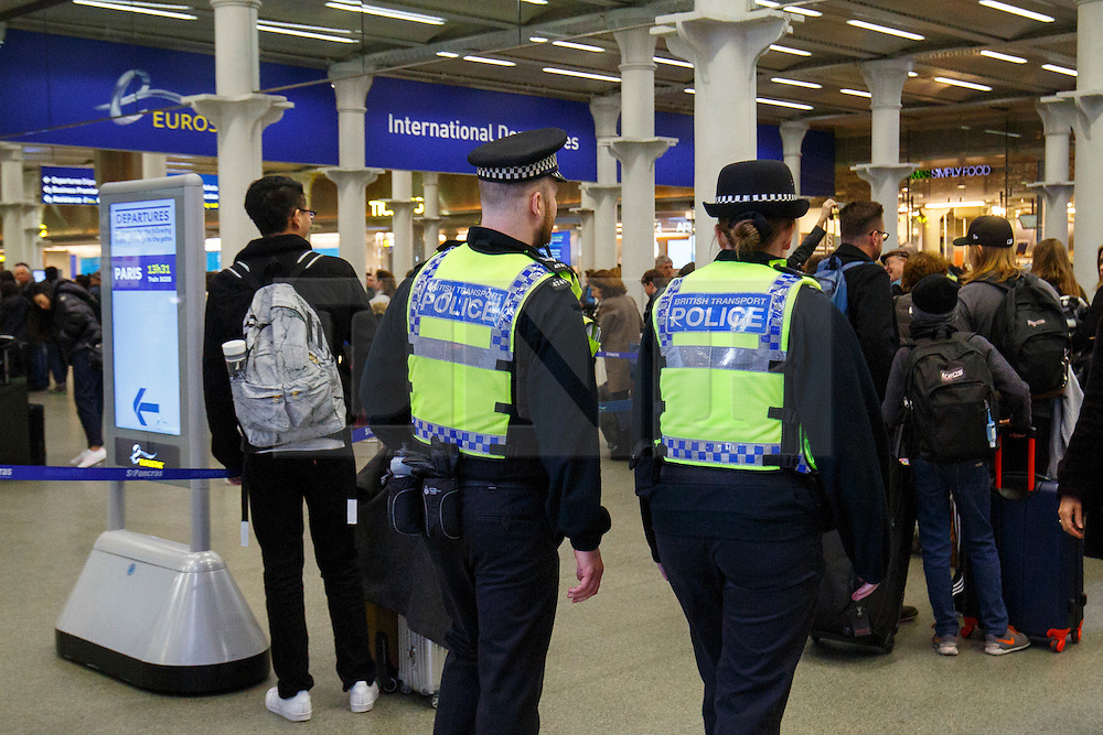 © Licensed to London News Pictures. 22/03/2016. London, UK. British Transport Police patrolling at London St Pancras Eurostar station as all Eurostar trains to Brussels have been cancelled the following the Brussels terror attacks on Tuesday, 22 March 2016. Photo credit: Tolga Akmen/LNP