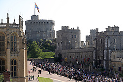 Fans gather within the grounds for the wedding of Prince Harry and Meghan Markle at Windsor Castle.