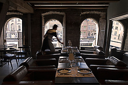 A waiter prepares for dinner service at the Belga Queen restaurant in Ghent, Belgium, on Friday, Sept. 12, 2008. (Photo © Jock Fistick)