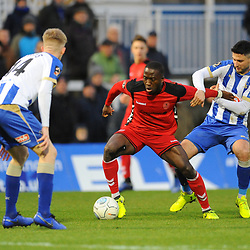 TELFORD COPYRIGHT MIKE SHERIDAN 12/1/2019 - Dan Udoh of AFC Telford takes on Harvey Rodgers during the Vanarama Conference North fixture between AFC Telford United and Hartlepool United at the Super Six Stadium.