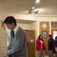101514      Cayla Nimmo<br /> <br /> Buddy Joe uses the official Navajo Nation voting booth to vote for the student council elections at Saint Michaels High School Wednesday.