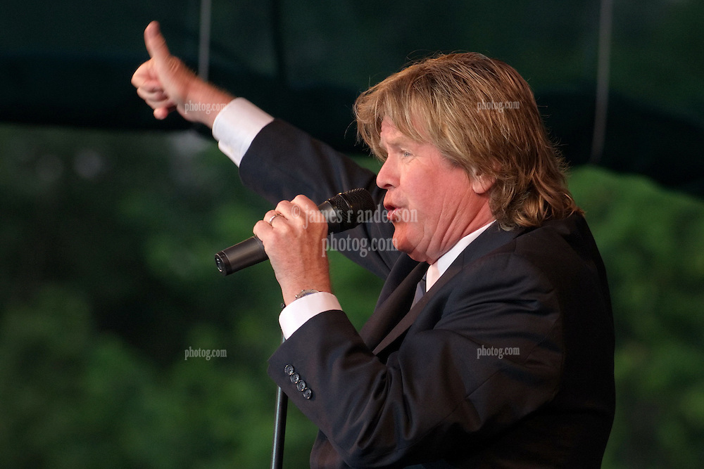Peter Noone, thumb up!, performing with Herman's Hermits at the Hamden Free Summer Concert Series. July 11, 2009 Town Center Park at Meadowbrook. Photo tweaked August 2011.