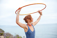 Woman with hoop and the sea and the sky.<br /> :::
