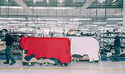 Tolentino, Poltrone Frau, creazione della plancia delle Ferraridagli artigiani di  Poltrone Frau. le pelli in transito dal magazzino