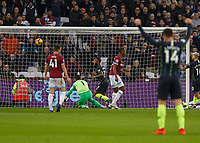 Football - 2018 / 2019 Premier League - West Ham United vs. Manchester City<br /> <br /> Raheem Sterling (Manchester City) slots home his teams second goal at the London Stadium<br /> <br /> COLORSPORT/DANIEL BEARHAM