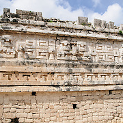 """Ornately decorated building at Chichen Itza Mayan ruins in Mexico. This is the side of """"La Iglesia"""" in the Las Monjas complex of buildings on the site."""