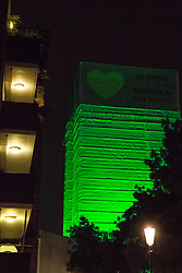 "London, UK. 14th June, 2018. The Green for Grenfell illuminations are lit at the Grenfell Tower, as well as at the twelve closest tower blocks, on the first anniversary of the fire in a display intended to 'shine a light"" of love and solidarity for all those affected and to raise awareness of the plight of those still without new homes after one year. Green for Grenfell is a community-led initiative in collaboration with tenants' and residents' associations and Grenfell United."