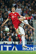 Champions League semi final second leg soccer match between Real Madrid and FC Bayern Munich at the Santiago Bernabeu stadium in Spain - <br /> MADRID 25/04/2012<br /> ESTADIO SANTIAGO BERNABEU.<br /> half final, Halbfinale, Semifinale,  CHAMPIONS LEAGUE<br /> REAL MADRID 2 - BAYERN 1<br /> picture: THOMAS MULLER. BENZEMA.- fee liable image, copyright © ATP QUEEN INTERNACIONAL<br /> <br /> Real MADRID vs Fc BAYERN Match 2:1 und 3:1 im Elfmeterschieflen - and 3:1 in penalty shooting - Queen photographer Fernando ALVAREZ