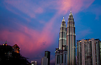 A stunning pink sunset sky in Kuala Lumpur makes a magnificent background for the spectacular Petronas Twin Towers.