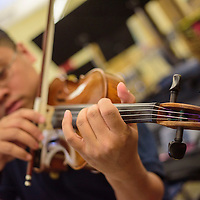 042015  Adron Gardner/Independent<br /> <br /> The fingers of Emmanuel Lalunio slide along the neck of his violin during Gallup Music Teacher's Ensemble practice at Gallup Middle School Monday.