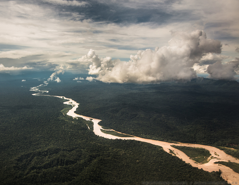 An aerial view of the Amazon jungle, home of the Tsimane, in Bolivia. They get most of their food from the river, the forest, or fields and gardens carved out of the forest.