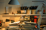 Work study area with white elbow lamp