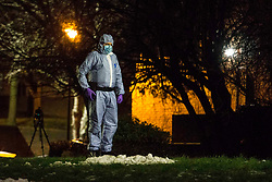 © Licensed to London News Pictures.25/01/2021, London,UK. A forensic officer gathers evidence AT THE crime scen after a fatal stabbing in Islington north London. At approximately 5:30pm police were called to a report of stabbing. Despite the effort of medics a teenage was pronounced dead at the scene. One male has been arrested. Photo credit: Marcin Nowak/LNP