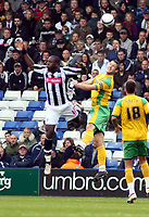 Photo: Mark Stephenson.<br /> West Bromwich Albion v Norwich City. Coca Cola Championship. 27/10/2007.Norwich's Jason Shackell wins the ball from Brom's Ishmael Miller