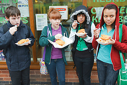 Teenagers eating fish and chips. Cleared for Mental Health Issues.
