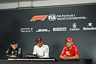 SINGAPORE - SEPTEMBER 16: Top 3 drivers: Lewis Hamilton (44) of Mercedes AMG Petronas Motorsport, Max Verstappen (33) of Aston Red Bull Racing, Sebastian Vettel (5) of Scuderia Ferrari during the Driver Press Conference at F1 Singapore Grand Prix 2018, Marina Bay Street Circuit, Singapore on September 16, 2018. <br /> .<br /> .<br /> .<br /> (Photo by: Naratip Golf Srisupab/SEALs Sports Images)<br /> .<br /> Any image use must include a mandatory credit line adjacent to the content which should read: Naratip Golf Srisupab/SEALs Sports Images