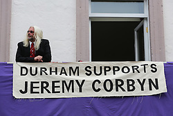 © Licensed to London News Pictures. 09/07/2016. Durham, UK. A man stands next to a large banner supporting Labour leader Jeremy Corbyn at the Durham Miners' Gala in County Durham, UK. The gala is a large gathering held annually associated with the coal mining heritage and trade unionism. Photo credit : Ian Hinchliffe/LNP