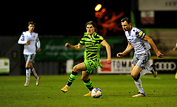 Josh Davison of Forest Green Rovers tries to hold off Tommy Smith of Colchester United - Mandatory by-line: Nizaam Jones/JMP - 27/02/2021 - FOOTBALL - The innocent New Lawn Stadium - Nailsworth, England - Forest Green Rovers v Colchester United - Sky Bet League Two