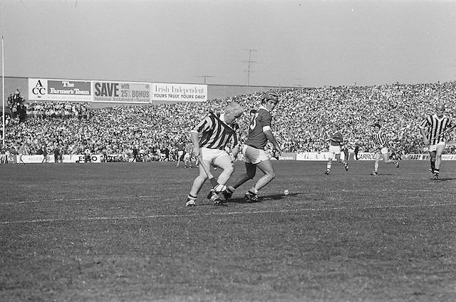 Kilkenny tries to get around Cork to gain possession during the All Ireland Senior Hurling Final, Cork v Kilkenny in Croke Park on the 3rd September 1972. Kilkenny 3-24, Cork 5-11.