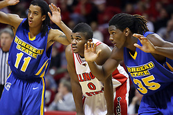 06 December 2008: Terrance Hill and Kenneth Faried double up on Osiris Eldridge on the free throw lane during a game where the  Illinois State University Redbirds extended their record to 9-0 with a 76-70 win over the Eagles of Morehead State on Doug Collins Court inside Redbird Arena on the campus of Illinois State University in Normal Illinois