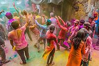 Procession during Chhadi Mar Holi (a local Holi, festival of colors, celebration), in the village of Gokul, near Mathura, Uttar Pradesh, India.