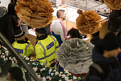 © Licensed to London News Pictures . 26/12/2013 . Manchester , UK . Police ensure there is no disorder as large numbers of shoppers crowd in to Selfridges . Queues for Selfridges in Manchester , ahead of an 8am opening . Thousands of shoppers queue for hours in freezing temperatures in Manchester this Boxing Day morning (26th December 2013) in order to be amongst the first to purchase reduced price products in shops' sales . Photo credit : Joel Goodman/LNP