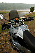 KTM 950 Adventure motorcycle in front of mist rising from Clayton Lake in southeastern Oklahoma.