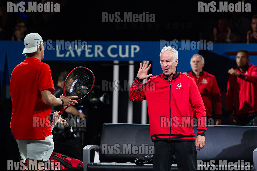 GENEVA, SWITZERLAND - SEPTEMBER 20: John McEnroe, Captain of Team World celebrates a point with Denis Shapovalov of Team World during Day 1 of the Laver Cup 2019 at Palexpo on September 20, 2019 in Geneva, Switzerland. The Laver Cup will see six players from the rest of the World competing against their counterparts from Europe. Team World is captained by John McEnroe and Team Europe is captained by Bjorn Borg. The tournament runs from September 20-22. (Photo by Monika Majer/RvS.Media)