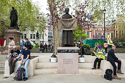 London, UK. 23rd April 2019. Ornamental trees placed next to a statue of Millicent Fawcett in Parliament Square by climate change activists from Extinction Rebellion. Trees were also placed alongside the statues of Nelson Mandela and Gandhi.