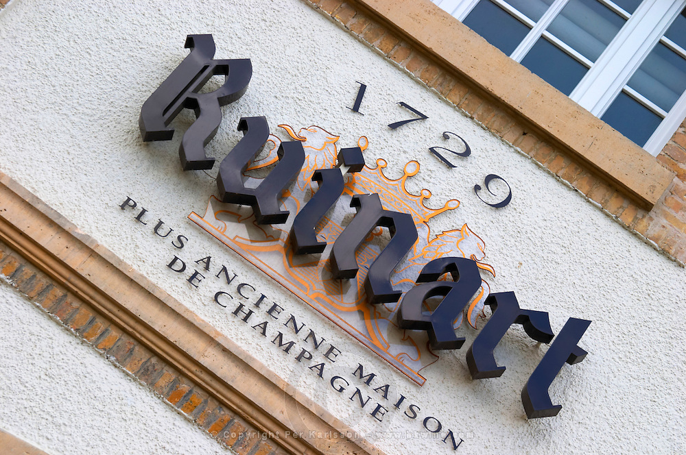 A sign on the winery saying Ruinart and that it is the oldest house in Champagne, Champagne Ruinart, Reims, Champagne, Marne, Ardennes, France