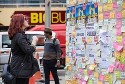 June 8, 2017 - London, London - London, UK. A woman reads messages left on a wall at London Bridge where eight people lost their lives in a terrorist attack on the evening of Saturday 3 June 2017. (Credit Image: © Rob Pinney/London News Pictures via ZUMA Wire)