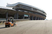 A forklift truck in front of the Tokyo National Stadium, Shinjuku, Tokyo, Japan. Friday October 24th 2014 The National Stadium was the venue for the first Tokyo Olympics in 1964 and is being rebuilt and remodelled in preparation for the 2020 Games