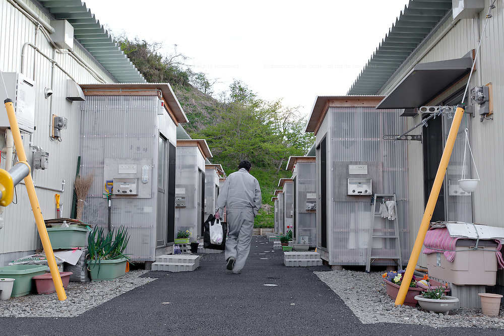 A man returns home from work to temporary housing units on the outskirts of Miharu, Tamura District of Fukushima, Japan, Wednesday May 1st 2013. Many people were moved into temporary housing after the earthquake and tsunami of march 11th 2011 left people homeless due to their houses being flattened in the tsunami or contaminated by radiation from the accident at Fukushima Daichi nuclear power station.