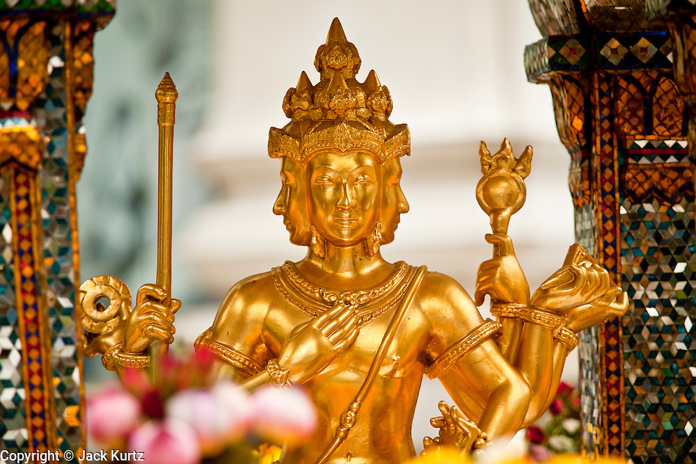 26 MARCH 2010 - BANGKOK, THAILAND:  The Erawan Shrine (Thai: San Phra Phrom) is a Hindu shrine in Bangkok, Thailand that houses a statue of Phra Phrom, the Thai representation of the Hindu creation god Brahma. The Erawan Shrine was built in 1956 as part of the government-owned Erawan Hotel to eliminate the bad karma believed caused by laying the foundations on the wrong date. The hotel's construction was delayed by a series of mishaps, including cost overruns, injuries to laborers, and the loss of a shipload of Italian marble intended for the building. Furthermore, the Ratchaprasong Intersection had once been used to put criminals on public display. An astrologer advised building the shrine to counter the negative influences. The Brahma statue was designed and built by the Department of Fine Arts and enshrined on 9 November 1956. The hotel's construction thereafter proceeded without further incident.      PHOTO BY JACK KURTZ