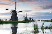 Group of authentic windmills early morning at Kinderdijk UNESCO World Heritage Site, polder, dyke, Holland, The Netherlands