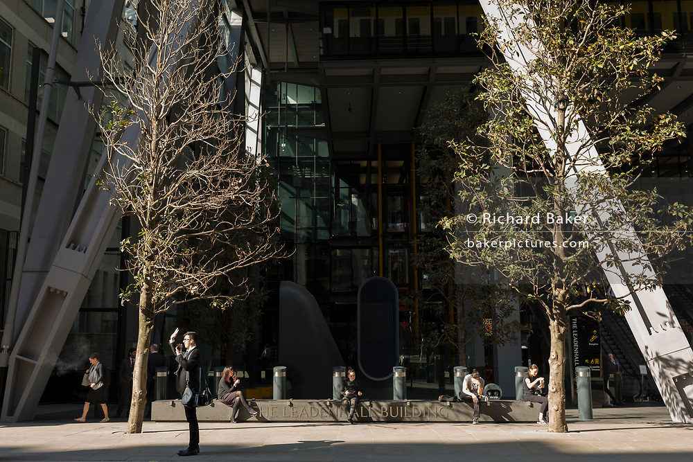 Londoners outside the exterior of the Leadenhall Building in the City of London - the capital's financial district (aka The Square Mile), 19th April 2018, in London, England.