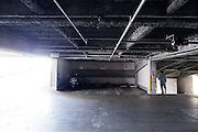 near empty parking garage with a person walking down