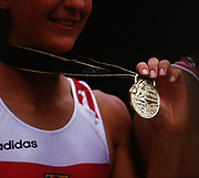 Atlanta, USA,  GER W4X   Kerstin KÖPPEN shows her gold medal to the photographers, on the awards dock after wiining the final at the 1996, Olympic Rowing Regatta at Lake Lanier, Gainsville Georgia,  [Photo Peter Spurrier/Intersport Images]  [RUTSCHOW-STOMPOROWSKI, Katrin, SORGERS, Jana, KÖPPEN, Kerstin and BORON, Kathrin]