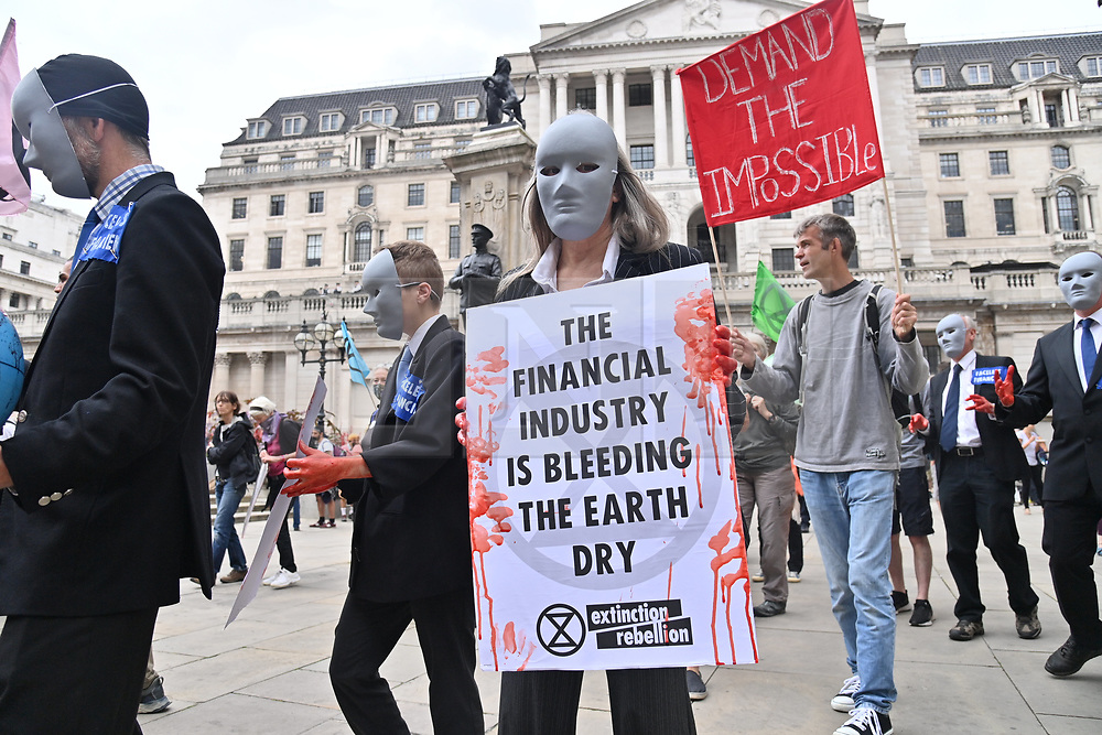 © Licensed to London News Pictures. 27/08/2021. London, UK. Protesters take part in EXTINCTION REBELLION'S THE IMPOSSIBLE REBELLION demonstration in the financial area of the City of London. Photo credit: Ray Tang/LNP