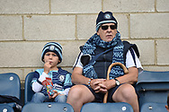 Young and old . Wycombe fans during the EFL Sky Bet League 1 match between Wycombe Wanderers and Oxford United at Adams Park, High Wycombe, England on 15 September 2018.