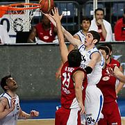 Anadolu Efes's Osman Gokhan Sirin (2ndR) during their Turkish Basketball League match Anadolu Efes between Erdemir at Arena in Istanbul, Turkey, Wednesday, January 28, 2012. Photo by TURKPIX