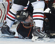The Ducks' Ryan Kesler ends up on the ice under a plethora of Chicago Blackhawks during the first period of Game 2 of the Western Conference Finals at Honda Center Tuesday.