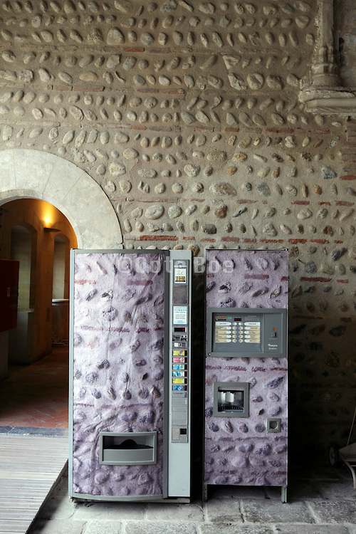 soft drinks and coffee machine in same pattern design as wall