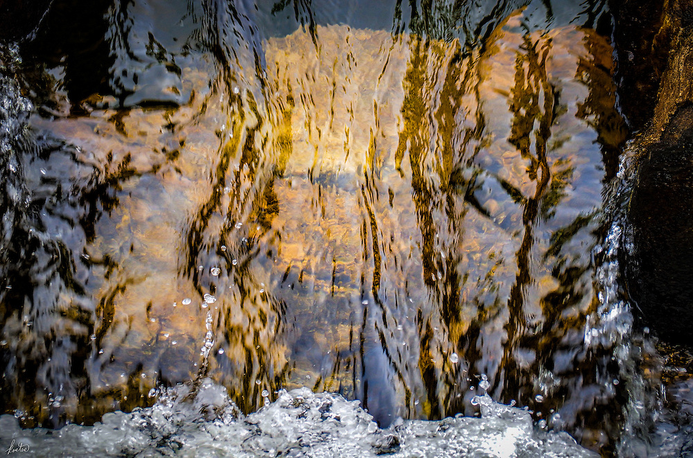 Bubbles in a small fast flowing waterfall.